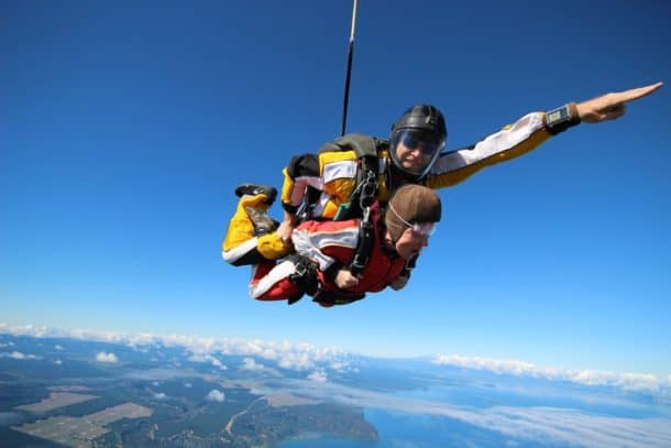 Happy skydiver enjoying the Lake Taupo view upon the sky